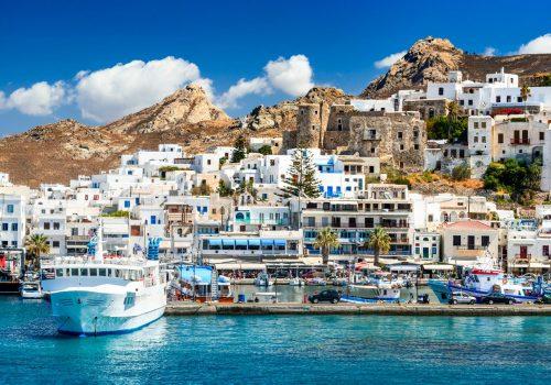 Naxos-island-port-boat-and-white-houses